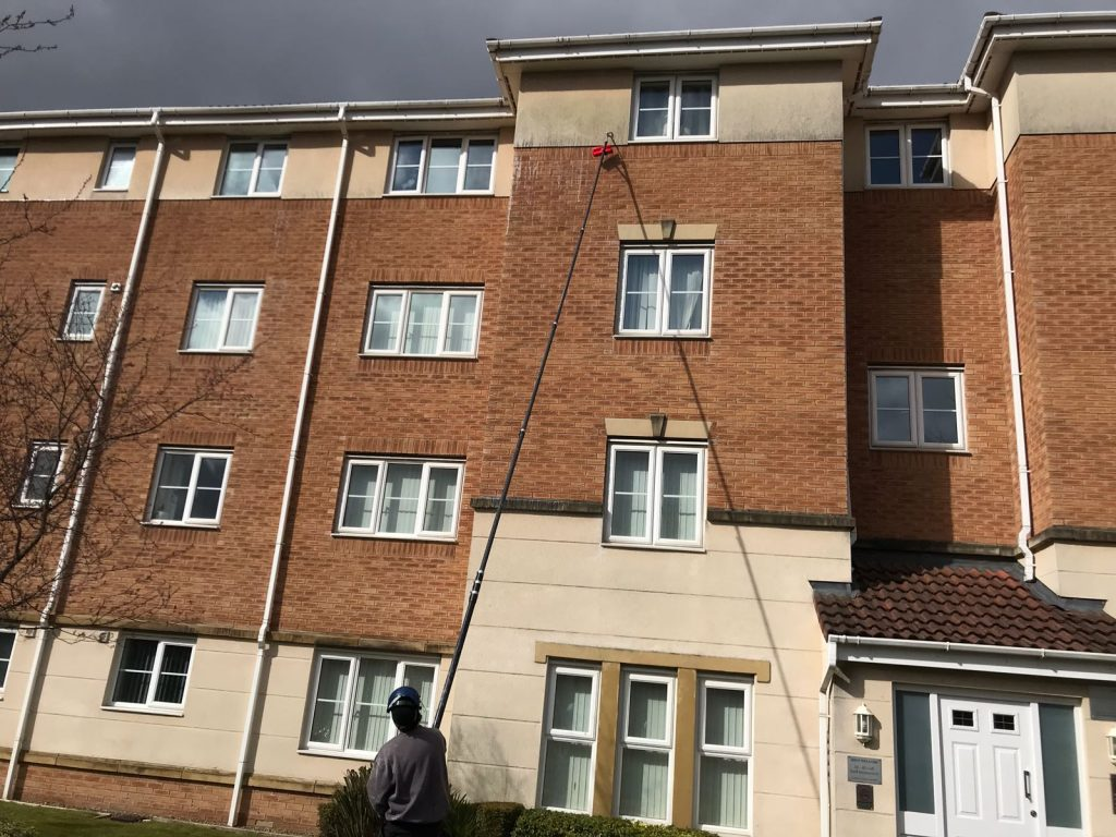 Render cleaning with extended pole in Alltrincham